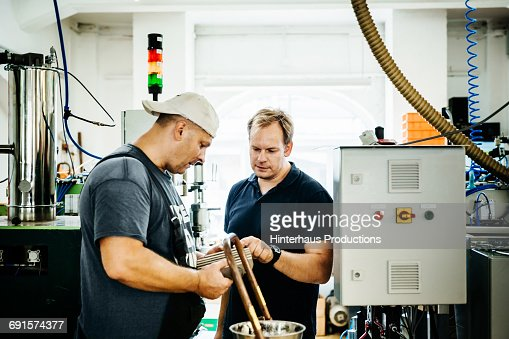 Worker and foreman discussing production results