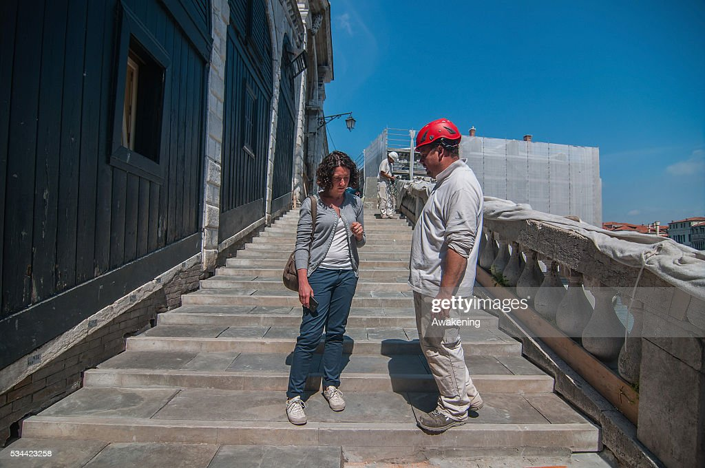 A worker and the work director talk during the renovation of the Rialto Bridge on May 26, 2016 in Venice, Italy. Site visits were organized to see the renovation of the Rialto bridge to coincide with the 15th Biennale of Architecture in Venice.