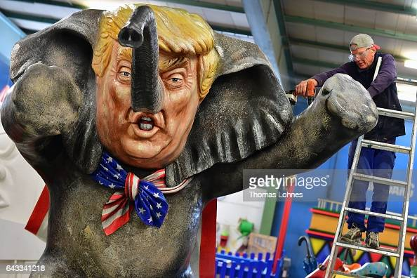 MCV worker Andre Menager works on a carnival float featuring an effigy of US President Donald Trump during a press preview at the MCV carnival...
