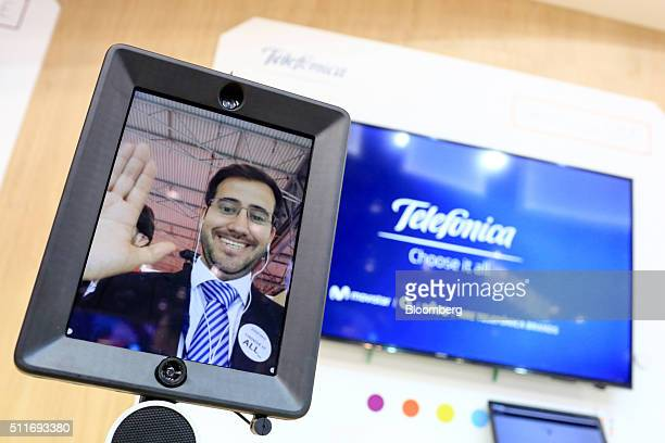 A worker appears on a Double Robotics telepresence device on the Telefonica SA stand at the Mobile World Congress in Barcelona Spain on Monday Feb 22...