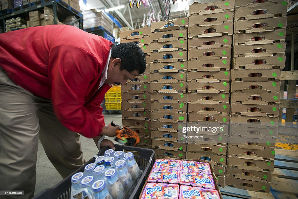 A worker applies price stickers to boxes of yogurt at a Wal-Mart Stores Inc. location in Mexico City, Mexico, on Thursday, June 20, 2013. Mexican retail sales rose 2.5 percent in April from the same month last year, the country's statistics agency, known as Inegi, reported on its website. Photographer: Susana Gonzalez/Bloomberg via Getty Images