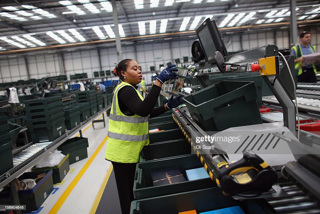 A worker arranges items in the giant semi-automated distribution centre where the company's partners process the online orders for the John Lewis department store on January 3, 2013 in Milton Keynes, England. John Lewis has published their sales report for the five weeks prior December 29, 2012 which showed online sales had increased by 44.3 per cent over the same period in 2011. Purchases from their website Johnlewis.com now account for one quarter of all John Lewis business.