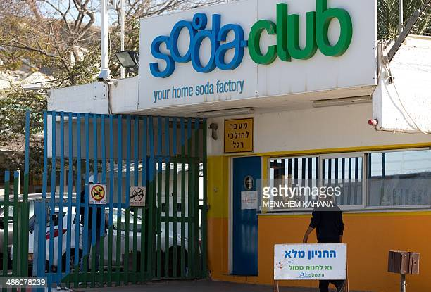 A worker arrives at the Israeli SodaStream factory on January 30 2014 in the Mishor Adumim industrial park next to the West Bank settlement of Maale...