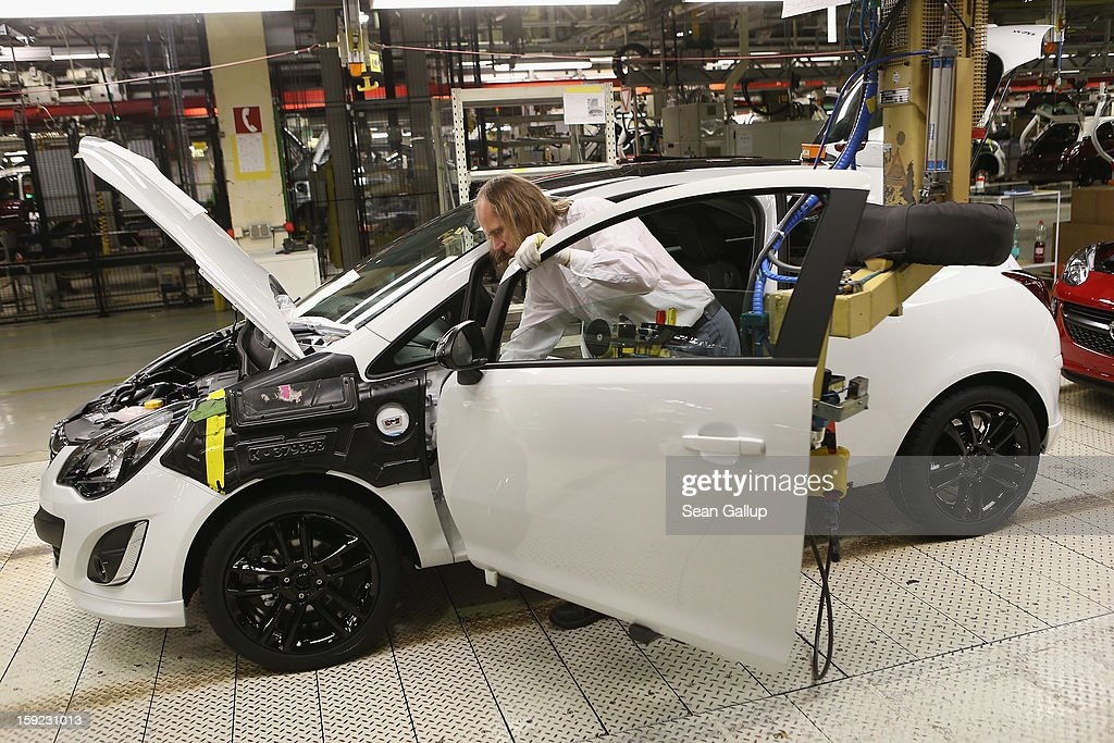 Worker assemble an Opel Corsa car at the Corsa and Adam assembly line at the Opel factory on January 10, 2013 in Eisenach, Germany. Opel employees hope the new Adam car will help the company return to profits after years of sagging sales and the announcement of the Bochum factory closure in 2016.