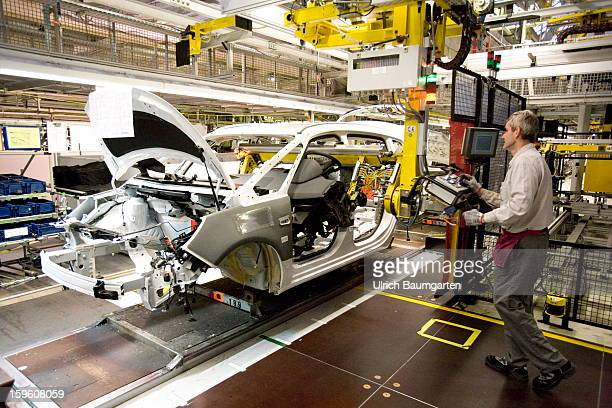 Worker assemble an Opel Zafira Tourer car at the Astra and Zafira assembly line at the Opel factory on January 16 2013 in Bochum Germany Its Adam...