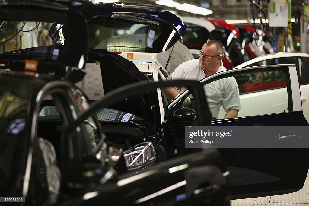 Worker assemble Opel Adam and Corsa cars at the Opel factory on January 10, 2013 in Eisenach, Germany. Opel employees hope the new Adam car will help the company return to profits after years of sagging sales and the announcement of the Bochum factory closure in 2016.