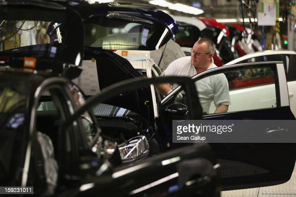 Worker assemble Opel Adam and Corsa cars at the Opel factory on January 10 2013 in Eisenach Germany Opel employees hope the new Adam car will help...