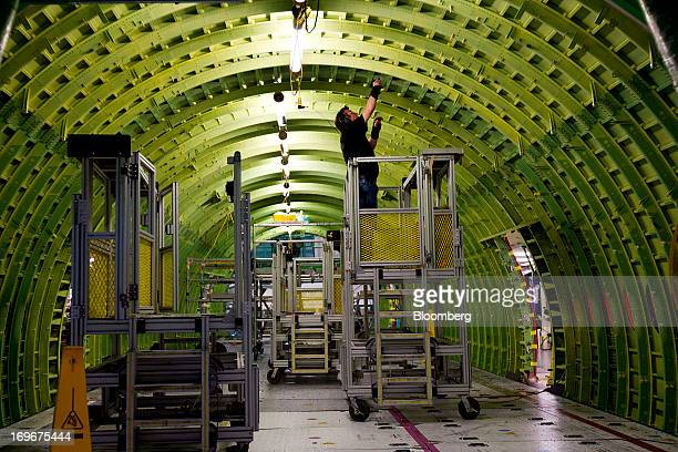 A worker assembles a Boeing Co 777 airplane at the company's production facility in Everett Washington US on Wednesday May 29 2013 Boeing Co won the...