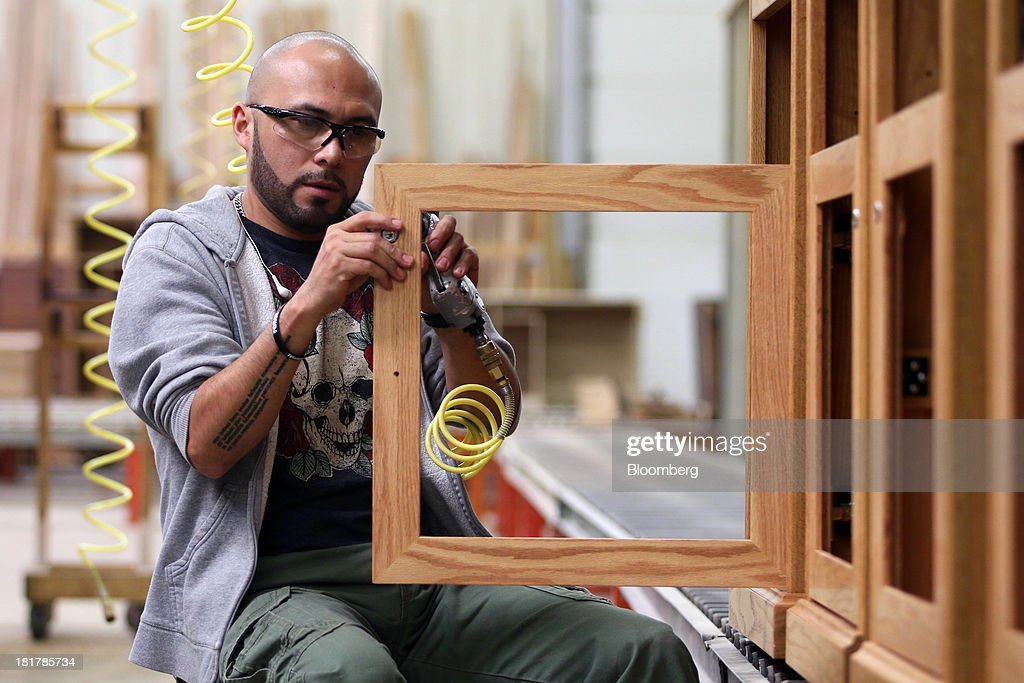 A Worker Assembles A Custom Piece Of Furniture At The At Baker Road  Furniture Manufacturing Facility