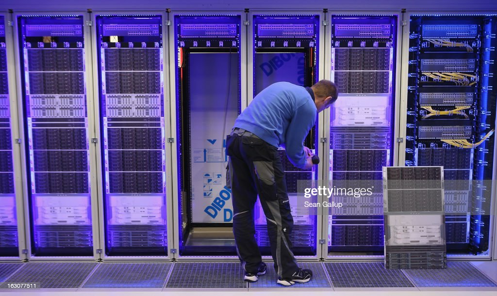 A worker assembles a data center module container at the Rittal stand at the 2013 CeBIT technology trade fair the day before the fair opens to visitors on March 4, 2013 in Hanover, Germany. CeBIT will be open March 5-9.
