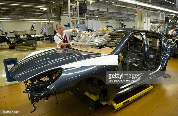 A worker assembles a Porsche Panamera model on the production line of the Porsche plant in Leipzig eastern Germany March 28 2012 Porsche's Leipzig...