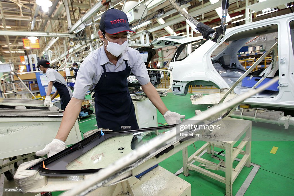 A worker assembles a Toyota Motor Corp. vehicle on the production line of PT. Toyota Motor Manufacturing Indonesia's (TMMIN) Karawang plant in Karawang, West Java, Indonesia, on Wednesday, Sept. 14, 2011. Toyota Motor Corp., the biggest carmaker in Asia, plans to build a second factory in Indonesia at a cost of 26.3 billion yen ($341 million) to help boost sales in emerging markets. Photographer: Dimas Ardian/Bloomberg via Getty Images