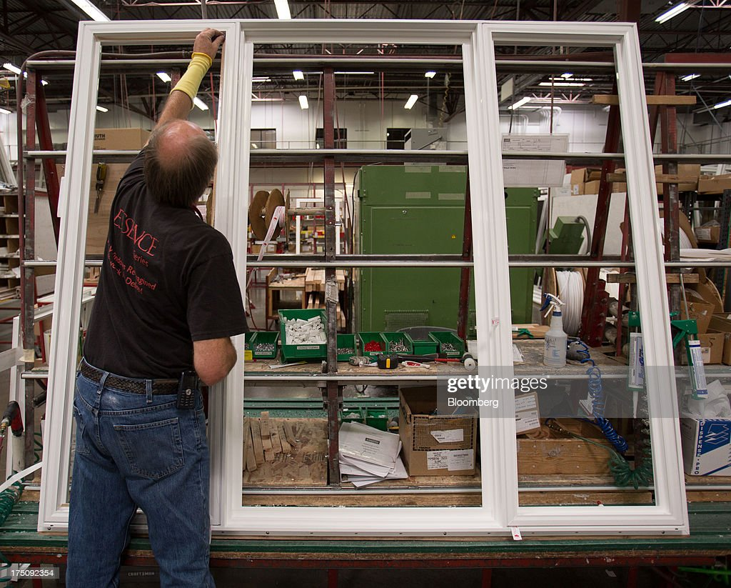 A worker assembles a vinyl window frame at the Milgard Windows & Doors' manufacturing facility in Tacoma, Washington, U.S., on Wednesday, July 24, 2013. The U.S. Census Bureau is scheduled to release monthly construction spending figures on Aug. 1. Photographer: Tim Rue/Bloomberg via Getty Images