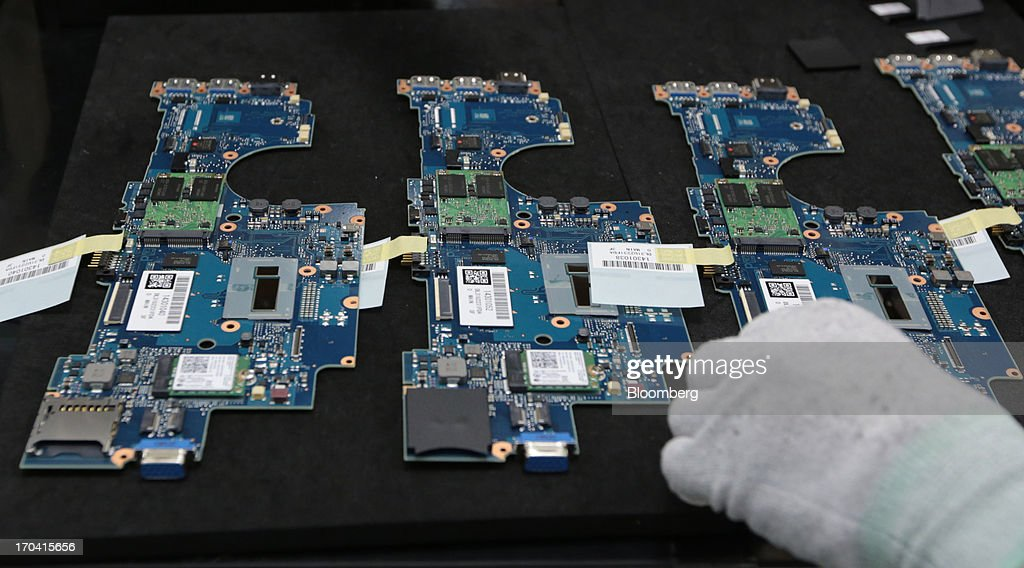 A worker assembles components of Panasonic Corp.'s Let's Note laptop computer on the production line at the company's plant in Kobe City, Hyogo Prefecture, Japan, on Tuesday, June 11, 2013. Panasonic manufactures electric and electronic products. Photographer: Yuriko Nakao/Bloomberg via Getty Images