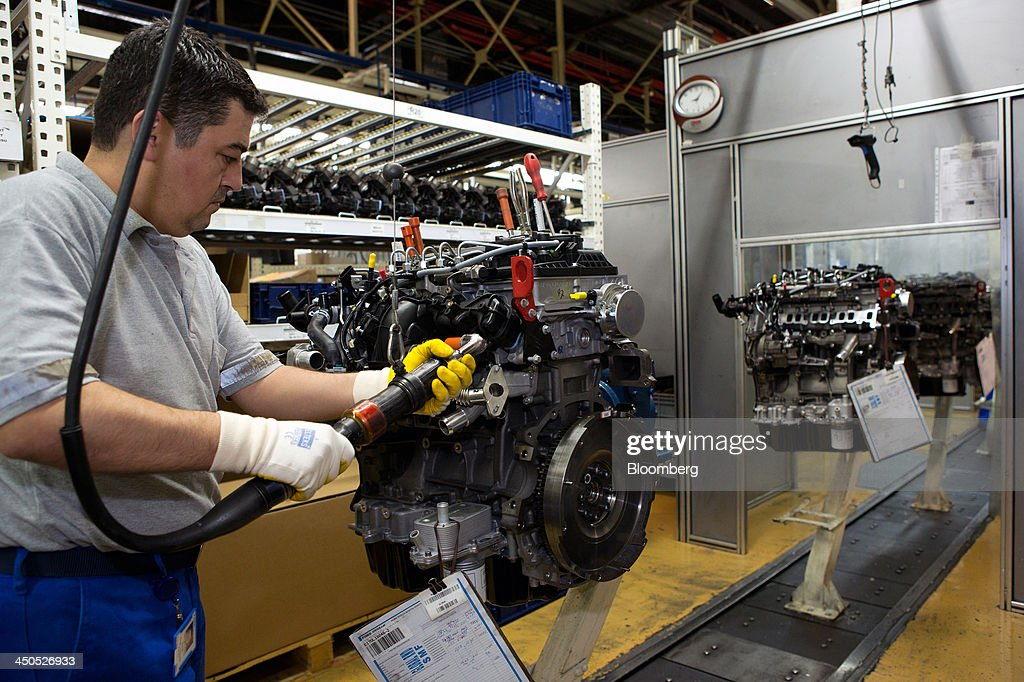 A worker assembles Ecotorq heavy duty diesel motors for Ford Cargo trucks on the engine production line at Ford Otosan, the joint venture between Ford Motor Co.'s Ford Otomotiv Sanayi AS and Koc Holding AS, in Eskisehir, Turkey, on Monday, Nov. 18, 2014. Ford Otomotiv Sanayi AS chief executive officer Haydar Yenigun said in September Turkey is about to 'lose the diamond' which is light commercial vehicle production due to government policies such as tax hikes, ban on their lease, Dunya newspaper says. Photographer: Kerem Uzel/Bloomberg via Getty Images
