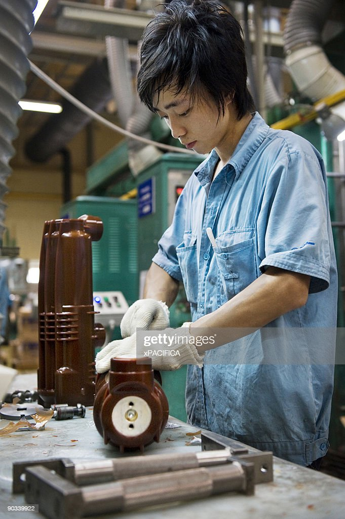 A worker assembles electrical parts. : Stock Photo