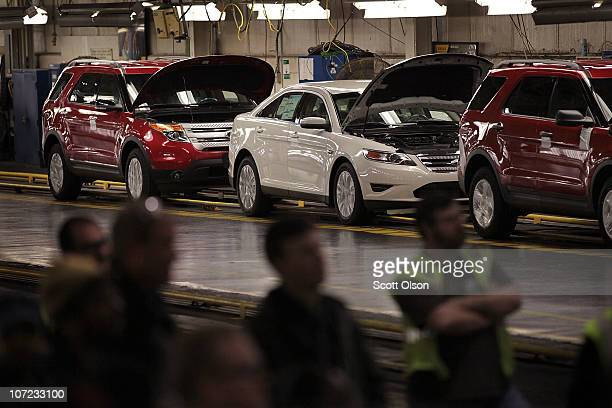 A worker assembles Ford vehicles at the Chicago Assembly Plant on December 1 2010 in Chicago IllinoisThe plant builds the Ford Taurus Explorer and...