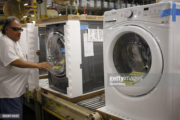 A worker assembles front loading machines at the Whirlpool Corp manufacturing facility in Clyde Ohio US on Wednesday Dec 9 2015 The US Census Bureau...