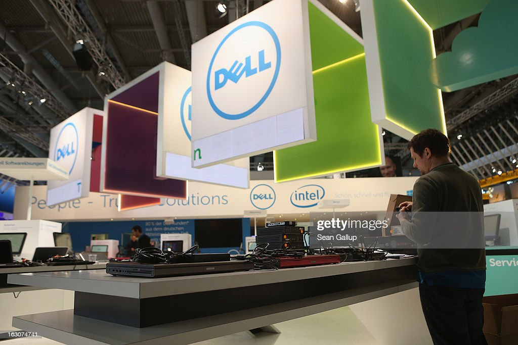 A worker assembles laptop computers at the Dell stand at the 2013 CeBIT technology trade fair the day before the fair opens to visitors on March 4, 2013 in Hanover, Germany. CeBIT will be open March 5-9.
