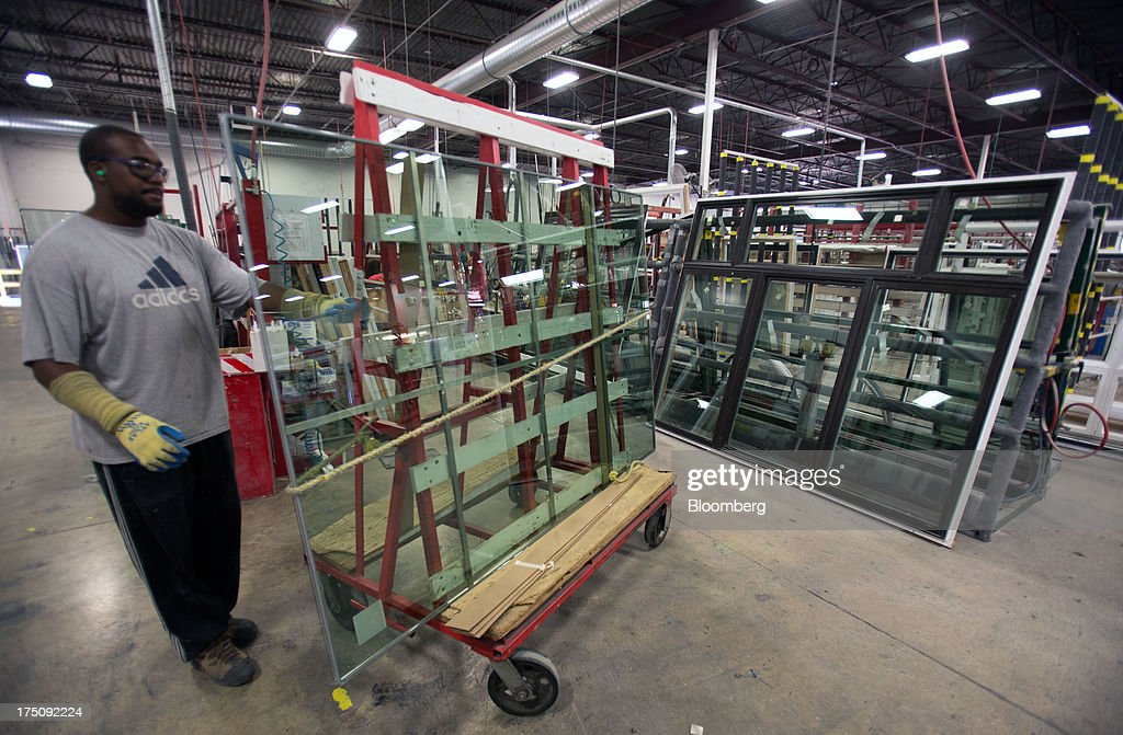 A worker assembles metal window frames at the Milgard Windows & Doors' manufacturing facility in Tacoma, Washington, U.S., on Wednesday, July 24, 2013. The U.S. Census Bureau is scheduled to release monthly factory orders figures on Aug. 2. Photographer: Tim Rue/Bloomberg via Getty Images