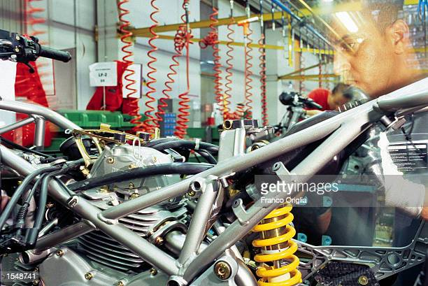 A worker assembles the frame for a Ducati Superbike at the Ducati factory September 12 2002 in Borgo Panigale Bologna Italy Ducati maker of...