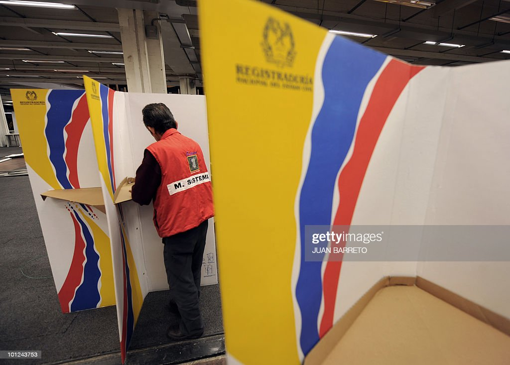 A worker assembles the voting booths at a polling center in Bogota, May 28, 2010. Colombia will hold presidential elections next May 30, and according to polls, a run-off election between Antanas Mockus for the Green Party and Juan Manuel Santos for the ruling National Unity Party, will take place on June 20.