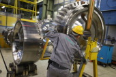 A worker assists in moving a disc of a gas turbine at the Siemens gas turbine plant on November 11 2012 in Berlin Germany Earlier in the Siemens...