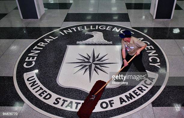 A worker at a Central Intelligence Agency headquarters cleans the lobby floor in advance of President George W Bush and Porter Goss director of the...