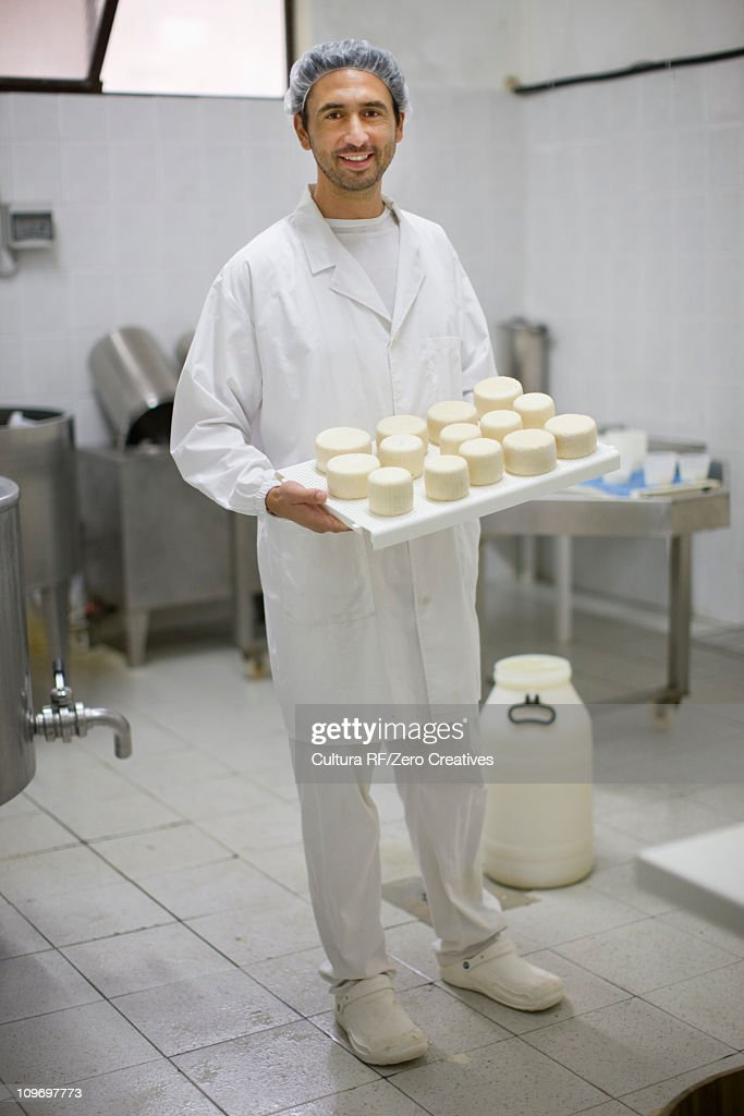 Worker at a cheese dairy : Stock Photo