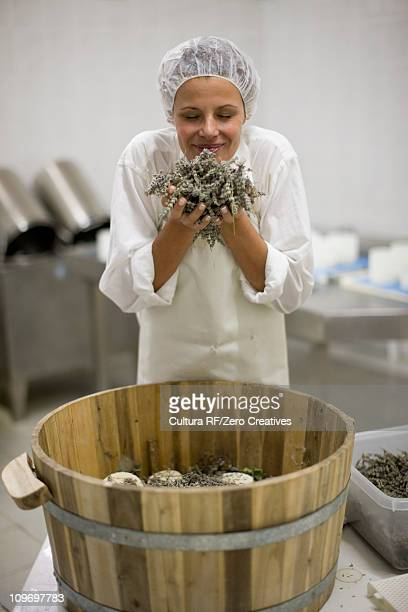 Worker at a cheese dairy