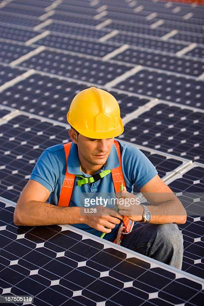 Worker at a photovoltaic farm