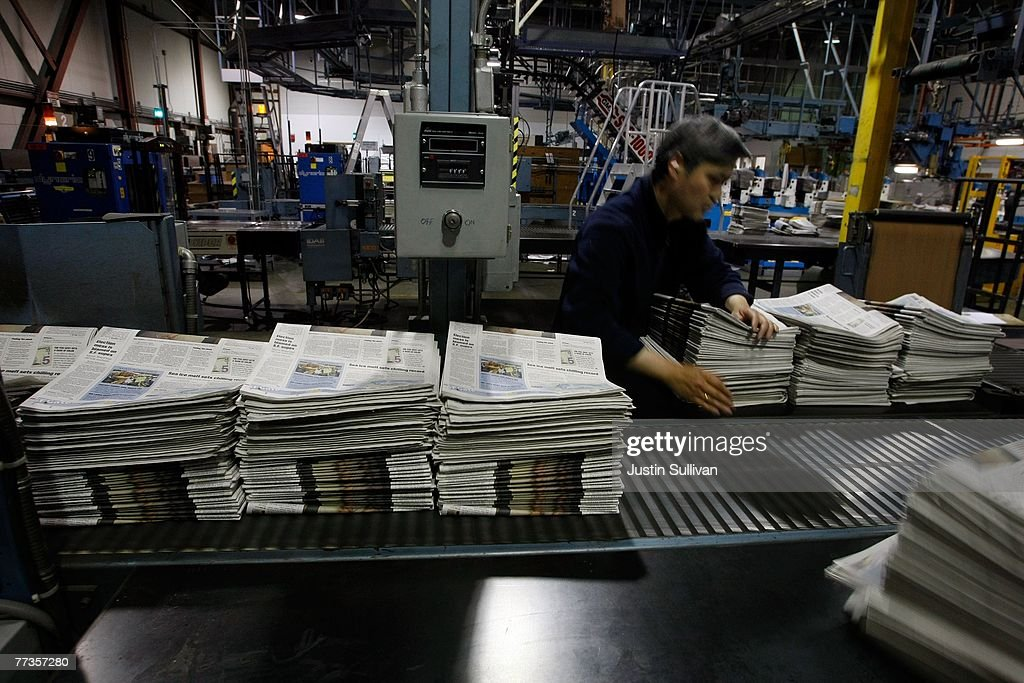 A worker at a San Francisco Chronicle printing facility arranges stacks of freshly printed newspapers September 20, 2007 in San Francisco, California. Newspaper sales in the U.S. continue to slide as people turn to the internet and television for their news. The Chronicle saw its circulation plunge more than 15 percent in 2006 to 398,000 during the week which has hurt newspaper vendor Rick Gaub's business. Unable to sell as many papers as he used to, Gaub is looking for a new way to earn money after selling papers for 42 years.
