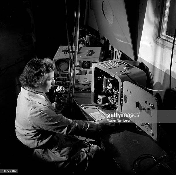 A worker at British Acoustic Films testing the sound system of the 640 Bell and Howell 16mm projector The Bell and Howell projector was extremely...
