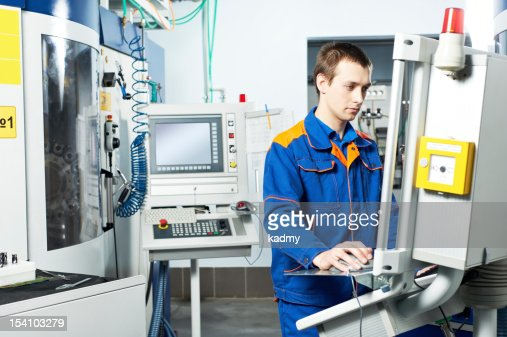 worker at machine tool in workshop : Stock Photo