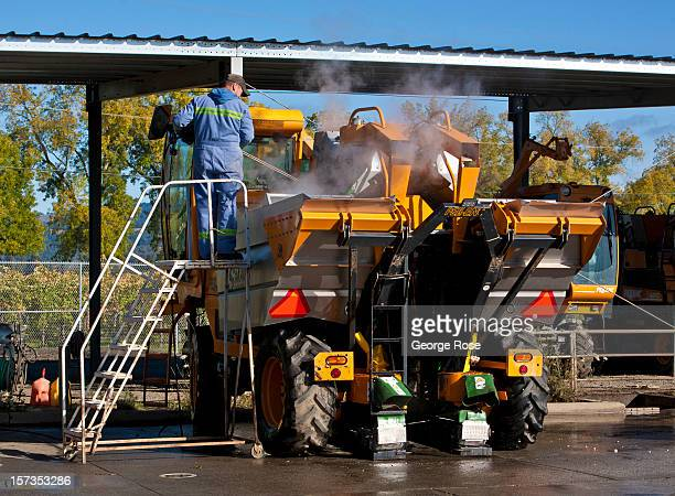 A worker at Robert Mondavi Winery spray washes a grape harvesting machine on November 9 near Rutherford California Excellent weather conditions...