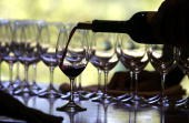 A worker at St Supery winery pours a glass of wine for a tasting September 20 2006 in Rutherford California Wineries in the Napa Valley region are in...