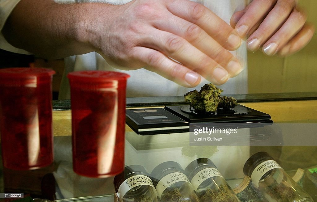 A worker at the Alternative Herbal Health Services cannabis dispensary weighs medicinal marijuana July 13, 2006 in San Francisco. San Francisco city planners are deciding July 13 if they will issue a permit to allow Kevin Reed to open the Green Cross medical marijuana dispensary right in the middle of San Francisco's Fisherman's Wharf area, a popular tourist destination.