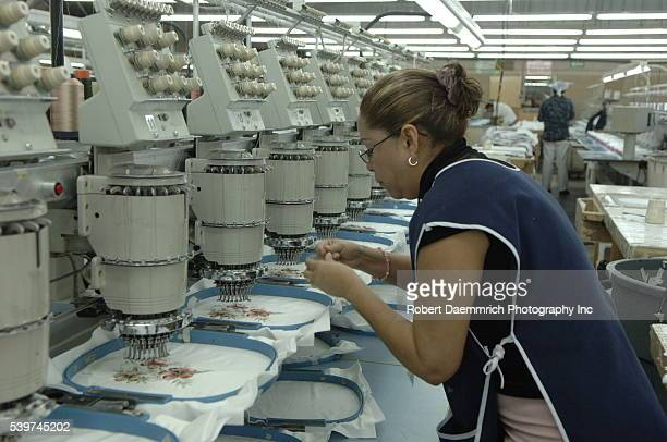 A worker at the BonWorth factory in Mexico monitors embroidery Machines on March 24 2006 Clothing manufacturer BonWorth factory has 650 employees...
