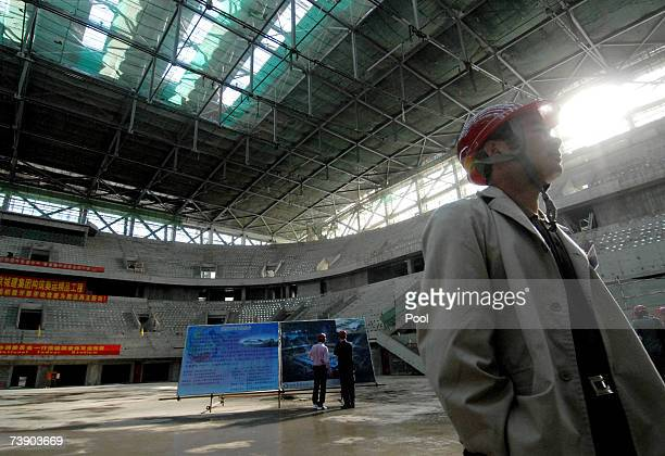 Worker at the construction site of Beijing National Stadium nicknamed the 'Bird Nest' on April 17 2007 in Beijing China The Stadium will be host to...