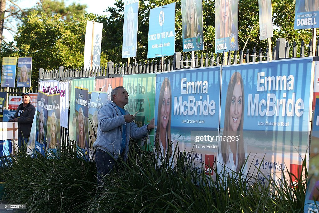 A worker at Woongarrah Public School in the electorate of Dobell puts up election posters on July 2, 2016 in Gosford, Australia. Voters head to the polls today to elect the 45th parliament of Australia.