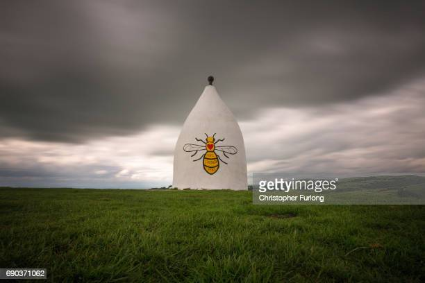 A worker bee adorns the side of Bollington White Nancy to remember those killed and injured in the Manchester Arena attack on May 30 2017 in...
