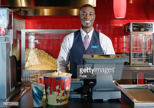 Worker Behind Concession Counter at Movie Theater