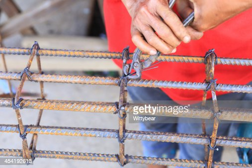 worker bending steel for construction job : Stock Photo