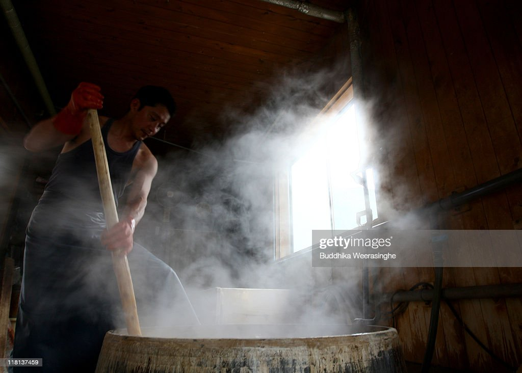 A worker boils the bark of mulberry trees at a mill that produces handmade paper at Iwano Heizaburo Seishi Sho Company in Echizen paper village on July 4, 2011 in Fukui, Japan. Washi paper is a tough paper, used for traditional Japanese arts such as Origami and Shodo, most commonly made from bark of the mulberry, gampi or mitsumata. The paper milling process is a traditional craft of the Echizen people dating back 1500 years which continues today along with modern paper manufacturing. Echizen city is home to many paper businesses, as well as the cultural museum of paper and papyrus centre where visitors can make their own paper.