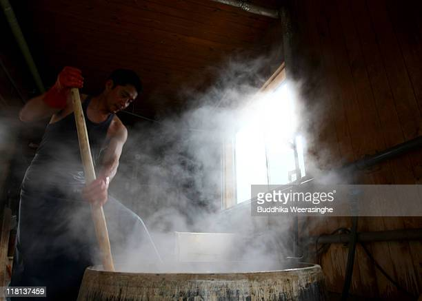 A worker boils the bark of mulberry trees at a mill that produces handmade paper at Iwano Heizaburo Seishi Sho Company in Echizen paper village on...