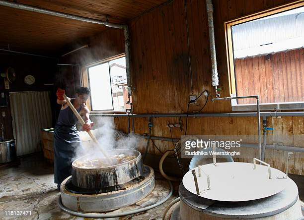 A worker boils the bark of mulberry wood at a mill that produces handmade paper at Iwano Heizaburo Seishi Sho Company in Echizen paper village on...