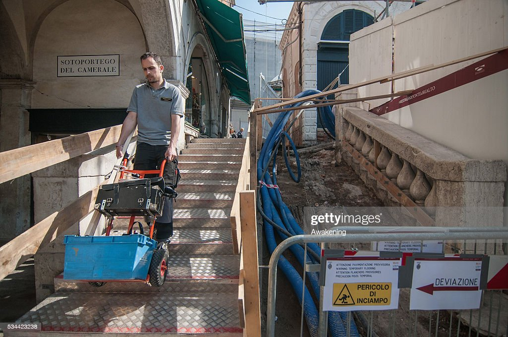 A worker brings some tools in the work area during the renovation of the Rialto Bridge on May 26, 2016 in Venice, Italy. Site visits were organized to see the renovation of the Rialto bridge to coincide with the 15th Biennale of Architecture in Venice.
