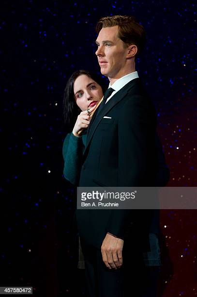 A worker brushes the new wax figure of Benedict Cumberbatch at Madame Tussauds on October 21 2014 in London England