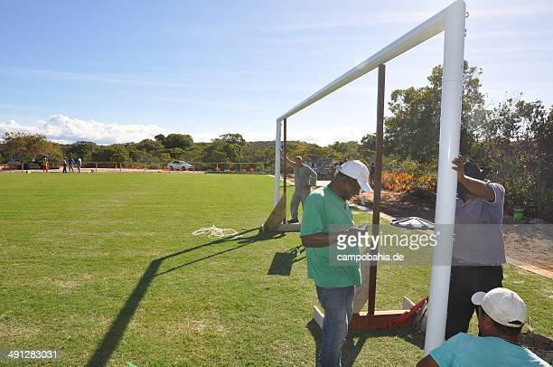 Worker build a goal a the new constructed training pitch on May 14 2014 at campo bahia in Santa Cruz Cabralia Brazil Campo bahia a newly created...