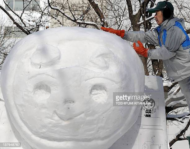 A worker builds a snow sculpture for the upcoming annual Sapporo Snow Festival in Sapporo on January 30 2012 The 63rd Sapporo Snow Festival will be...